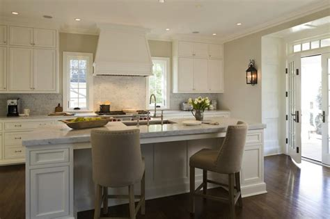 white kitchen island with stools upholstered counter stools transitional kitchen