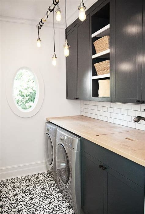 laundry room floor cabinets black and white laundry room with beveled mirrored subway