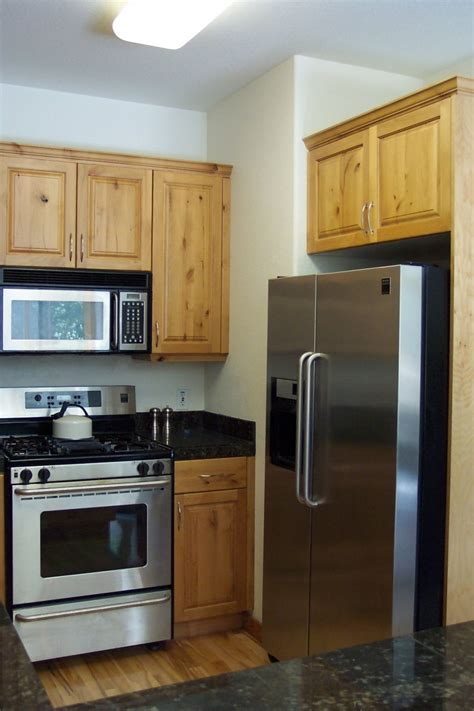 small wooden cabinets with doors designing small kitchens with modern refrigerator with