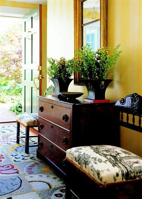 yellow foyer entryway creating a fabulous impression