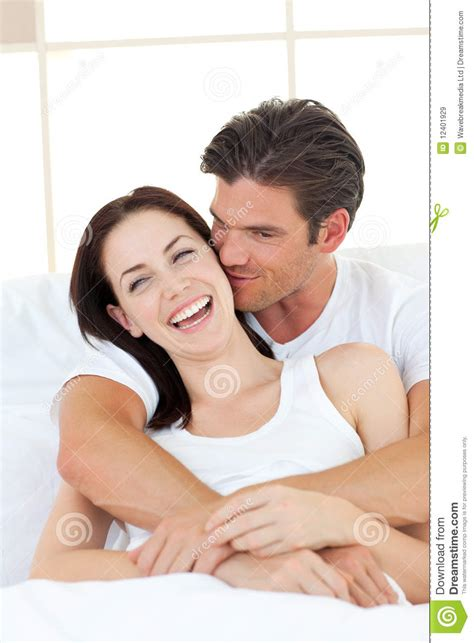 bedroom kissing man kissing his laughing girlfriend in the bedroom royalty free stock images image