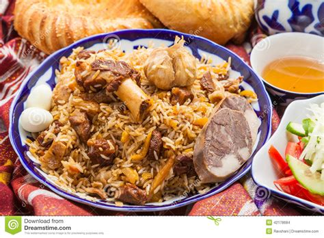 uzbek national cuisine main courses uzbek national food pilaf on traditional fabric adras