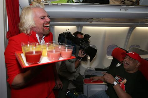 airasia redhouse richard branson shaves legs and sports red lipstick and