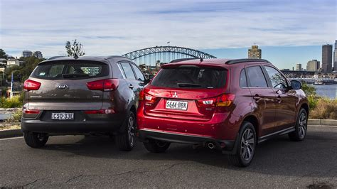 mitsubishi asx size kia sportage v mitsubishi asx comparison review photos