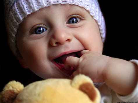 Wallpaper Of Cute Baby Doll | cute baby playing doll wallpapers hd wallpapers id 576