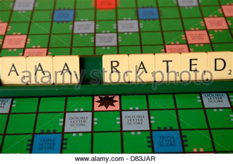 scrabble ratings aaa credit rating spelled out on a scrabble board stock