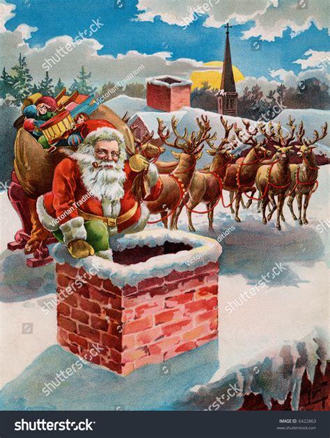 rooftop santa and reindeer santa reindeer sleigh on roof top stock photo 6422863