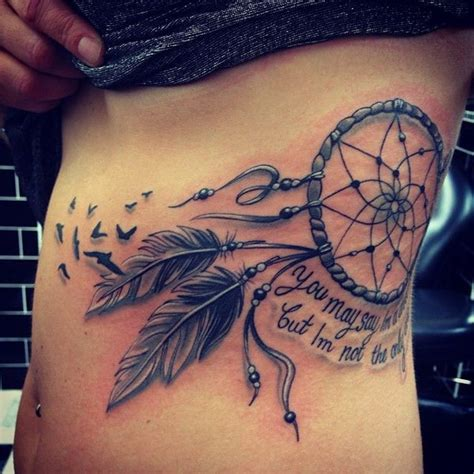 birds tattoos for you bird tattoo on rib cage 29 dreamcatcher tattoos with birds