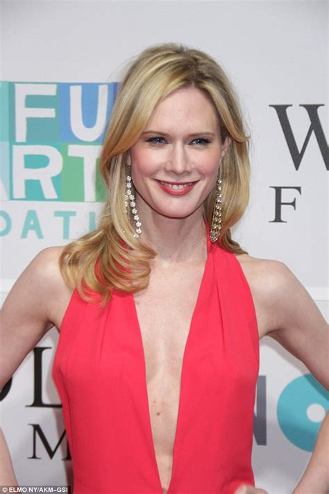 stephanie march stephanie march looks stunning in plunging jumpsuit at