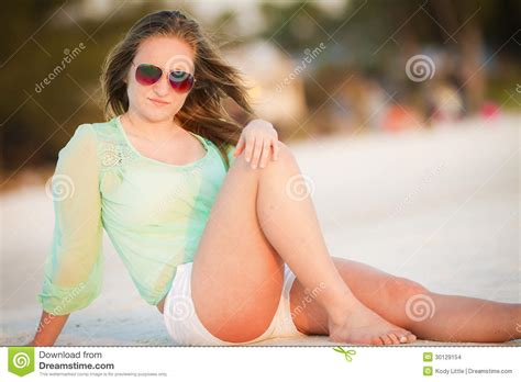 Little Young Girl Paradise | teen girl enjoying the beach stock images image 30129154