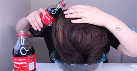 rinsing hair with coke she pours 2 bottles of coca cola all over her hair the