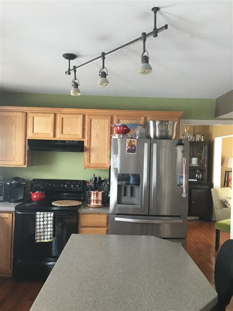 track lights in kitchen have angled track lighting in kitchen want pendant lights