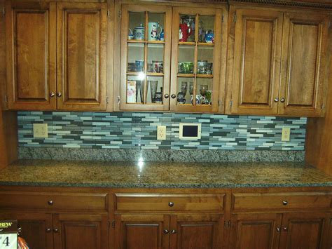 kitchen with backsplash advantages of using glass tile backsplash midcityeast