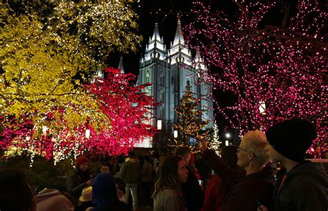 lights on temple square welcome visitors from