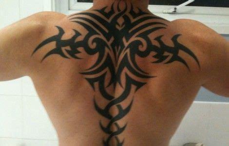 back tattoo man jumping upper back tribal tattoos for men tattoos pinterest