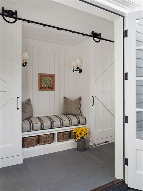 farmhouse white sliding storage bench i m just obsessed with this barn doors built in bench