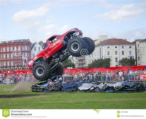 videos of monster trucks crushing cars extreme monster truck editorial image cartoondealer com
