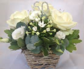 flower arrangement in oasis for 60th wedding anniversary by moss of buckingham florist