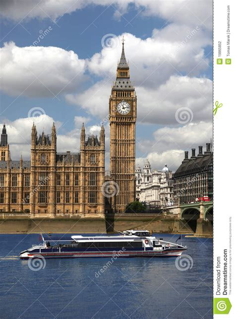 big boat in london big ben with speed boat london uk stock photography