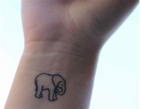 tiny elephant tattoo small and dainty elephant wrist 171 inked inspiration