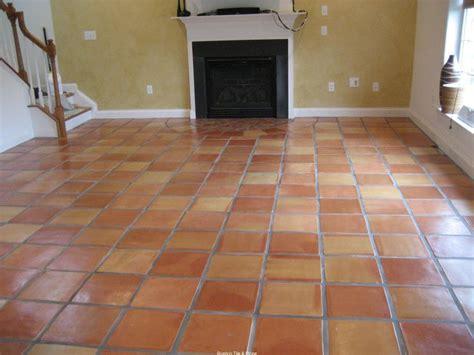 saltillo tile with white baseboards decor ideas