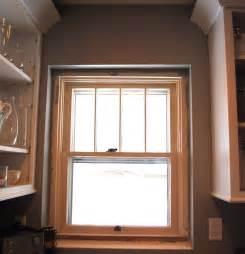 And white farmhouse bathroom on farmhouse style exterior window trim