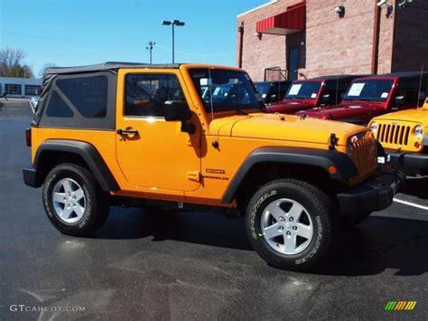 2012 jeep wrangler colors 2012 dozer yellow jeep wrangler sport s 4x4 62159028