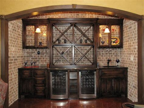 wet bar with wine fridge backed with faux brick home