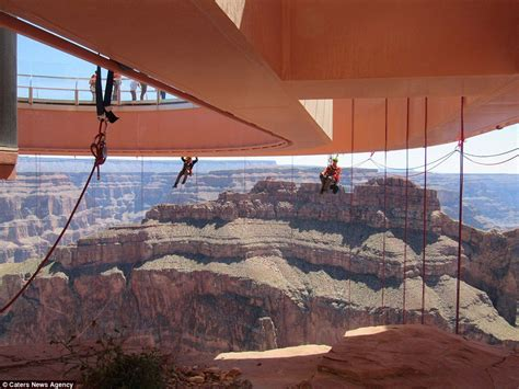 grand canyon rope swing cost window cleaners polish skywalk high above grand canyon