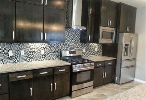 kitchen with custom mosaic glass cabinet hardware by uneek manhattan builders custom home beautiful kitchen with