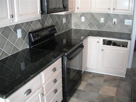 kitchendaltile granite uba tuba  white cabinets