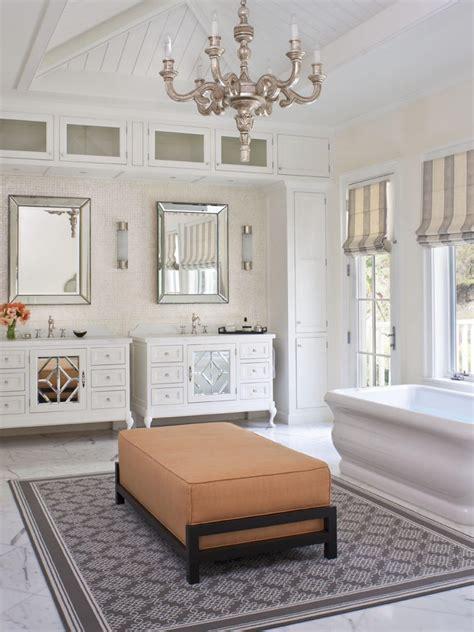 transitional master bathroom  chandelier  seating