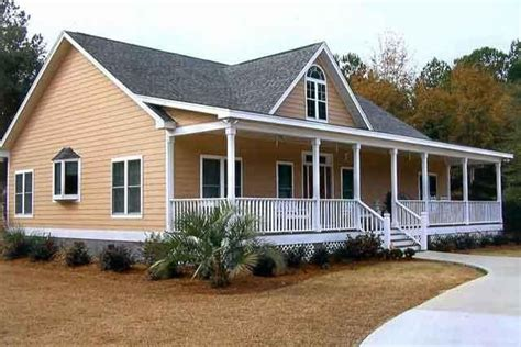 houses with big porches it s gotta a big front porch for our wooden rockin chairs home