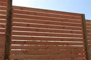 palissades en bois couleur jardin