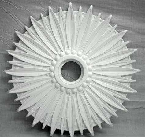 ceiling rosette design with modern light fixture