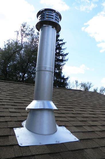 Fireplace Chimney Pipe by Chimney Pipe Installation For Wood Stoves Through A Flat