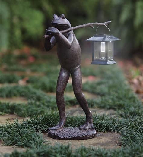 trekking frog statue carries a removable pole and separate