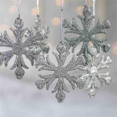 silver glittered snowflake ornaments snow snowflakes