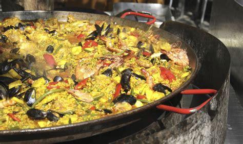 cucinare la paella di pesce come cucinare la vera paella spagnola