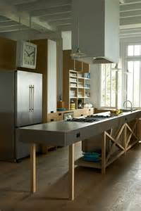 zink freestanding island wooden shelving kitchen design