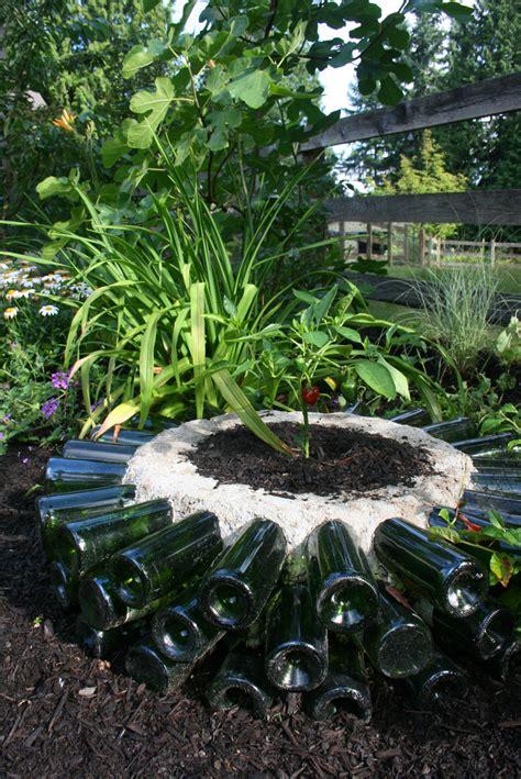 wine bottle garden 25 diy ideas to recycle your wine bottles