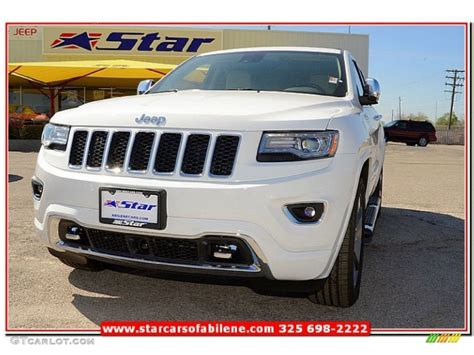 light brown jeep 2014 bright white jeep grand cherokee overland 4x4