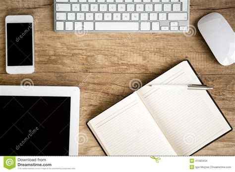 Notebook Wooden Table notebook wit tablet on wooden table stock photo image