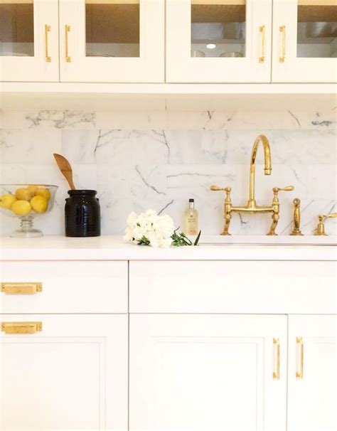 white cabinets with gold hardware kitchen with gold accents transitional kitchen