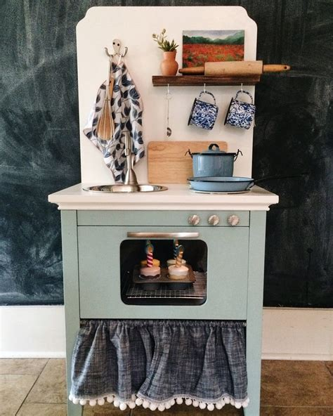 diy play kitchen for kid from old nightstand furniture turn an old nightstand into a play kitchen diy projects