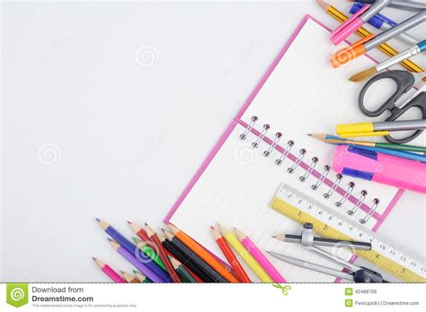 office drawing tools open notebook and school or office tools on white