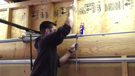 How To Tighten The Garage Door Spring Youtube Tightening Garage Door Springs
