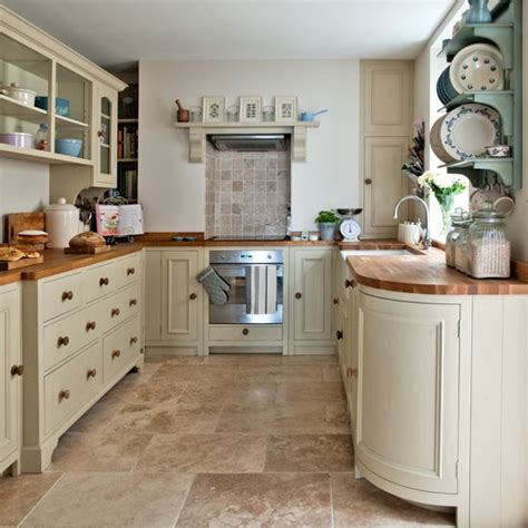 modern country kitchen housetohome co uk neutral kitchen with feature plate rack step inside this