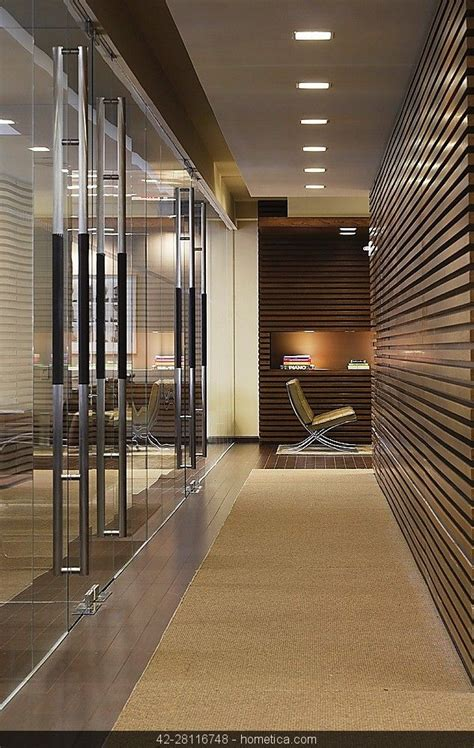 contemporary modern minimalistic entrance hallway office with wood panel recess light wood and