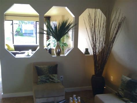 How To Decorate Wall Cutouts by Divider Wall With Cut Outs Creates A Lack Of Privacy
